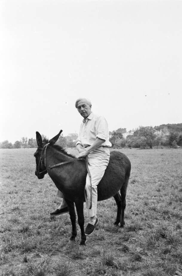 Robert Bresson And The Donkey, Star Of His Film 'Au Hasard, Balthazar,' in April 1966.  Bresson was a great filmmaker, but entirely to be avoided when traveling by air.  Too slow, too subtle. Photo: MENAGER Georges, Paris Match Via Getty Images / Paris Match Archive