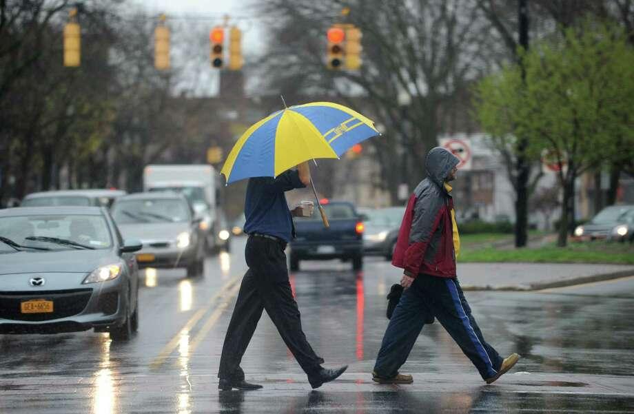 Pedestrians cross a rain soaked Central Ave. near Lark St. Wednesday, April 30, 2014, in Albany, N.Y.  (Lori Van Buren / Times Union) Photo: Lori Van Buren