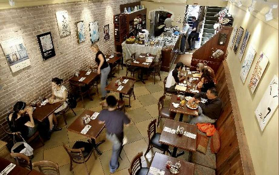 The interior is cramped at Zazie, but the spirit is convivial. Photo: Brant Ward, The Chronicle 2008