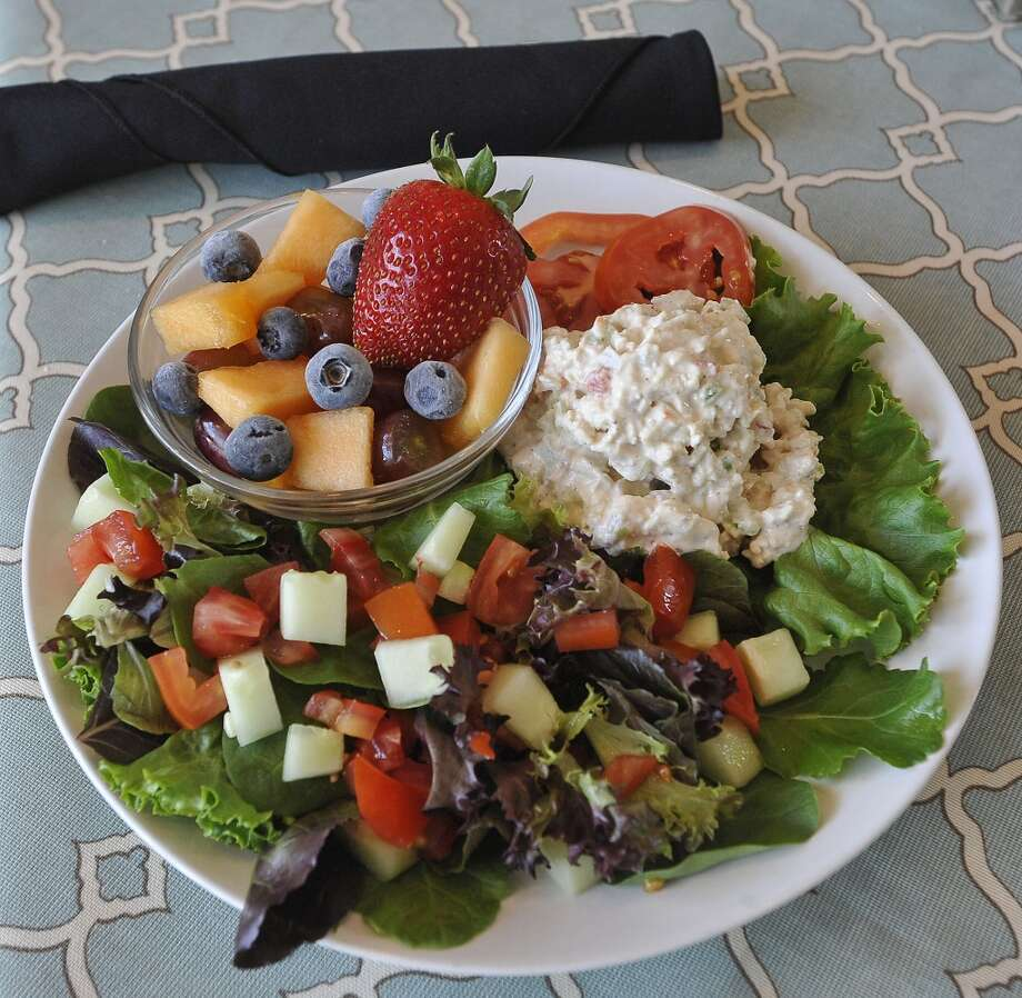 The Two Magnolias Cafe is located inside the Art Museum of Southeast Texas on Main Street in Beaumont. This dish is called a Salad Trio and contains chicken salad, a green salad, and a fruit salad.  This is the restaurant of the week for the 10/04/12 edition of Cat 5. Dave Ryan/The Enterprise Photo: Dave Ryan/The Enterprise