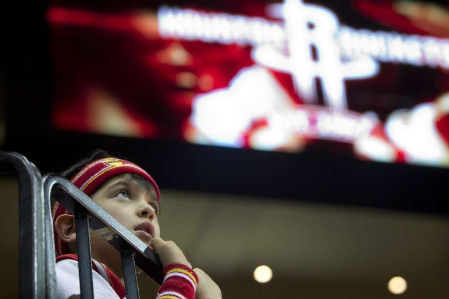 A young Rockets fan watch the Rockets warm up before Game 5. Photo: Brett Coomer, Houston Chronicle
