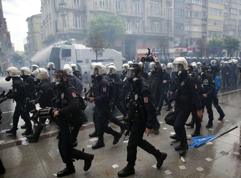 Riot police use water cannons and teargas to disperse thousands of people trying to reach the city's main Taksim Square to celebrate May Day in Istanbul, Turkey, Thursday, May 1, 2014. The government deployed about 40,000 police officers in Istanbul and closed the main roads leading to Taksim Square. Photo: Emrah Gurel, Associated Press