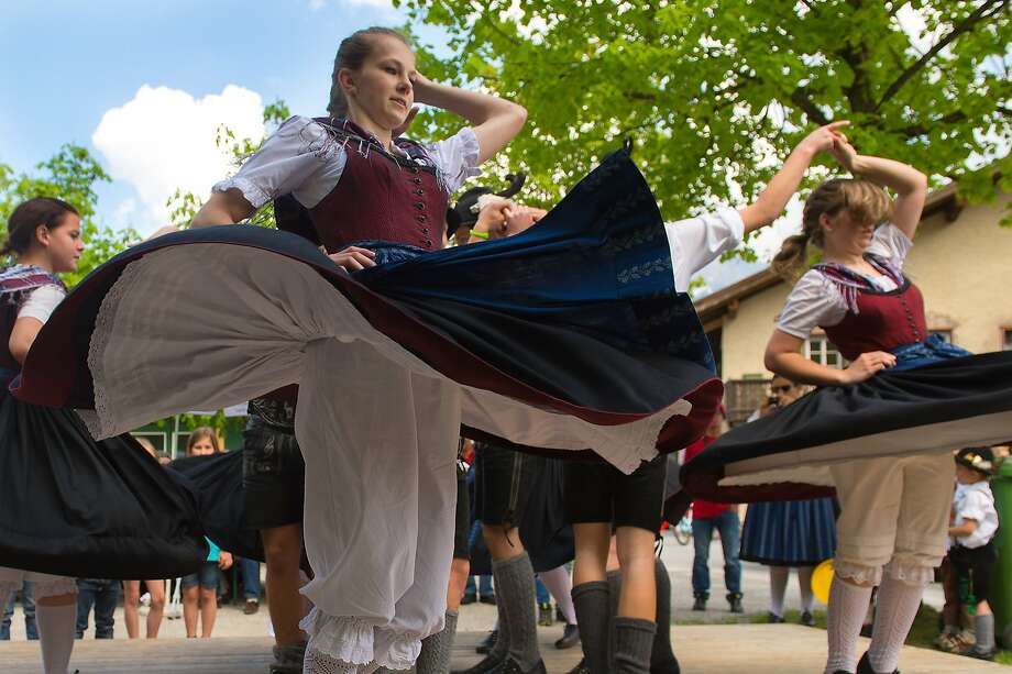 Traditionally dressed dancers perform during the May Day celebrations in Lofer in the Austrian province of Salzburg, on Thursday, May 1, 2014.  Photo: Kerstin Joensson, Associated Press