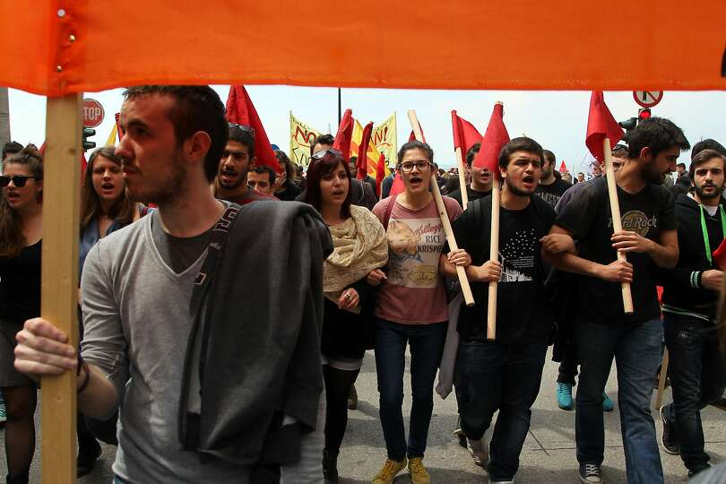 Demonstrators march in May Day protests in the Northern Greek city of Thessaloniki on Thursday, May