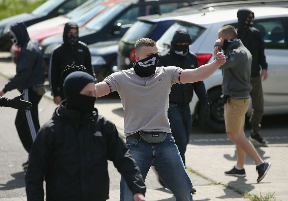 Anti-Nazi activists taunt supporters of the far-right NPD political party marching on May Day in Dierkow district on May 1, 2014 in Rostock, Germany. Left-wing protesters repeatedly blocked the route of the approximately 250 NPD supporters and at one point attacked them with rocks. May Day gatherings and protests are taking place across Germany today and the one in Rostock was the NPD's main march.  Photo: Sean Gallup, Getty Images