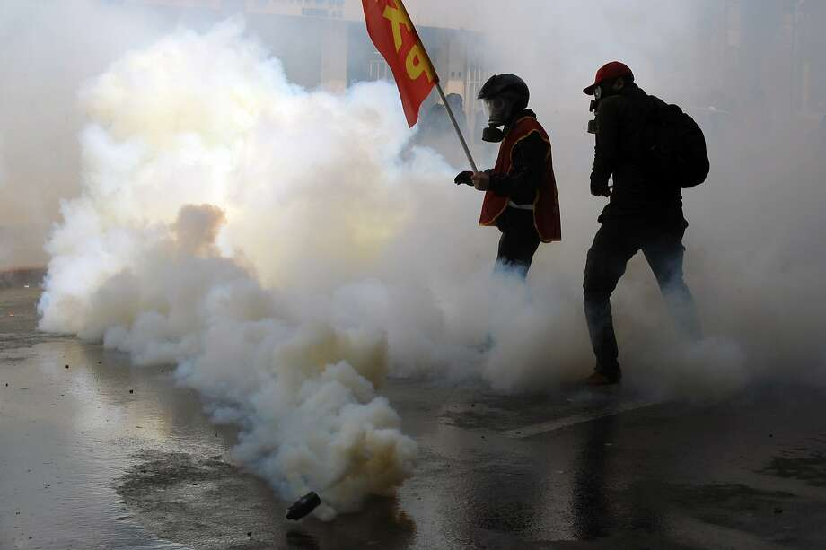 Turkish riot police use water cannons and tear gas to disperse protesters during a May Day demonstration on May 1, 2014 in Istanbul, Turkey. Turkish police fired water cannon and tear gas on Thursday in an attempt to prevent hundreds of protesters from defying a ban on May Day rallies and reaching Istanbul's central Taksim Square, the focal point of protests last summer.  Photo: Burak Kara, Getty Images