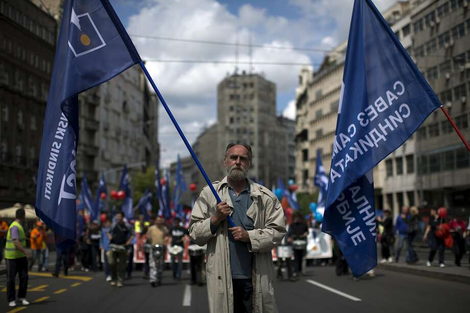 Members of workers' unions attend a May Day protest in Belgrade, Serbia, Thursday, May 1, 2014. Various labor groups staged a protest in Belgrade in order to voice their concern over the expected austerity measures announced by Serbia's new government. Photo: Marko Drobnjakovic, Associated Press