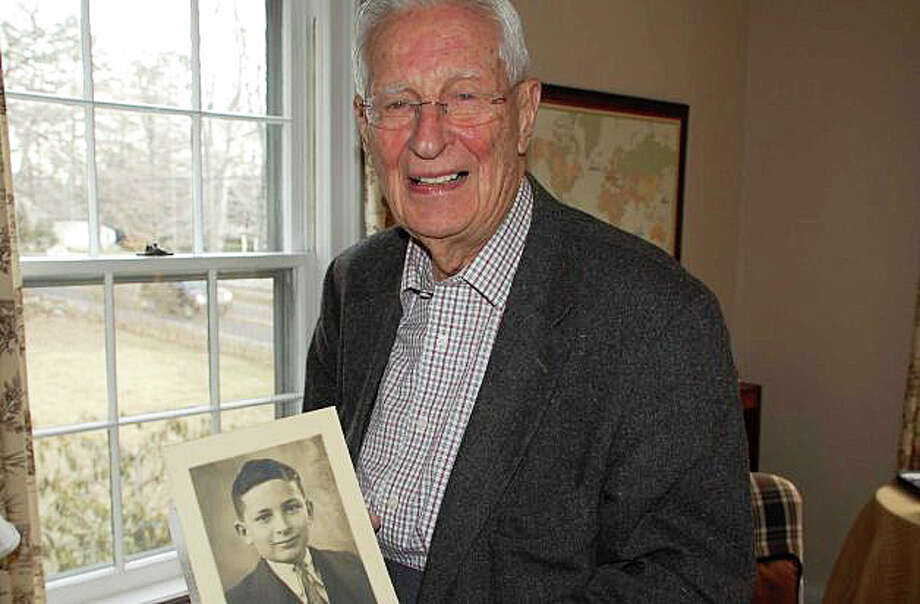 "Allen Raymond Jr. in a photo from February 2013 holds a photo of himself a photo of himself at age 11 in 1934 from Buffalo, N.Y., following a piano recital. It reads, ""In appreciation of your excellent performance in the Julliard Series."" Photo: File Photo / Westport News"