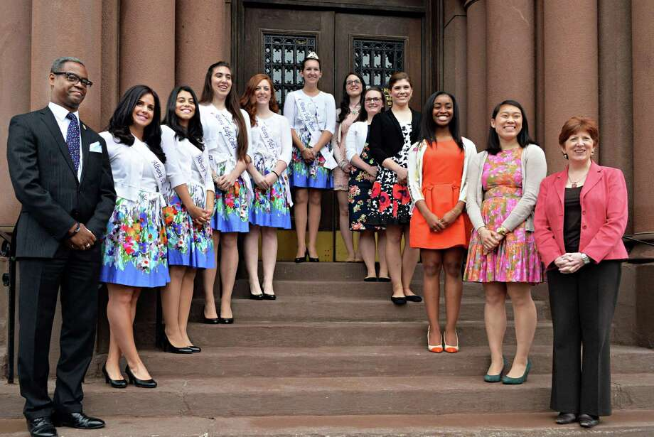 Tulip Festival Chairman Marcus Pryor, left, and Mayor Kathy Sheehan, right, pose with the 2013 Tulip Queen finalists, left, and the five finalists for 2014 Tulip Queen Thursday, May 1, 2014, at City Hall in Albany, N.Y.  (John Carl D'Annibale / Times Union) Photo: John Carl D'Annibale / 00026651A