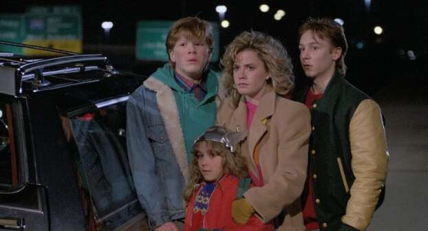"""Adventures in Babysitting"" – When Chris agrees to baby-sit for the Andersons after her boyfriend stands her up, it's hardly the boring night she expected. Chris takes the kids along on an errand to downtown Chicago, but one flat tire leads to an outrageous all-night fiasco. Available Now! Photo: Netflix"