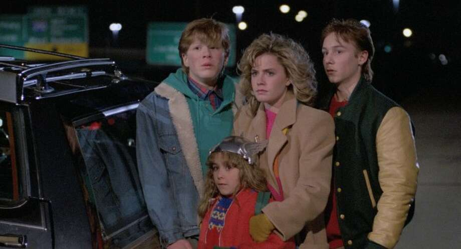 """""""Adventures in Babysitting""""– When Chris agrees to baby-sit for the Andersons after her boyfriend stands her up, it's hardly the boring night she expected. Chris takes the kids along on an errand to downtown Chicago, but one flat tire leads to an outrageous all-night fiasco.Available Now! Photo: Netflix"""
