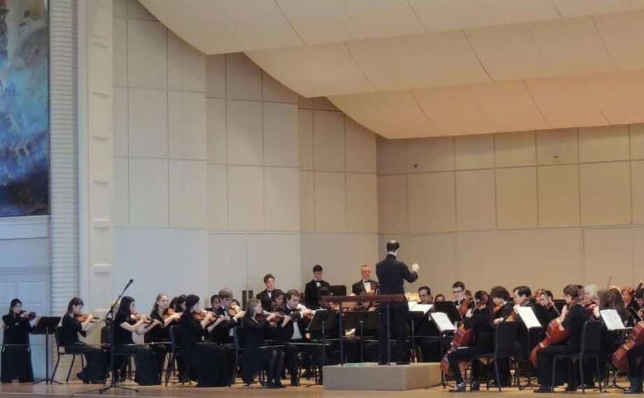 Jonathan Yates, center, conducts the Norwalk Youth Symphony and the NSO during a previous concert. Yates and the Norwalk Youth Symphony, along with several other conductors will present the group's annual Mother's Day concert on Sunday, May 11, 2014, at the Norwalk Concert Hall in Norwalk, Conn. The Mother's Day Concert marks the end of the Norwalk Youth Symphony's 2013-14 concert season. Photo: Contributed Photo / Stamford Advocate Contributed