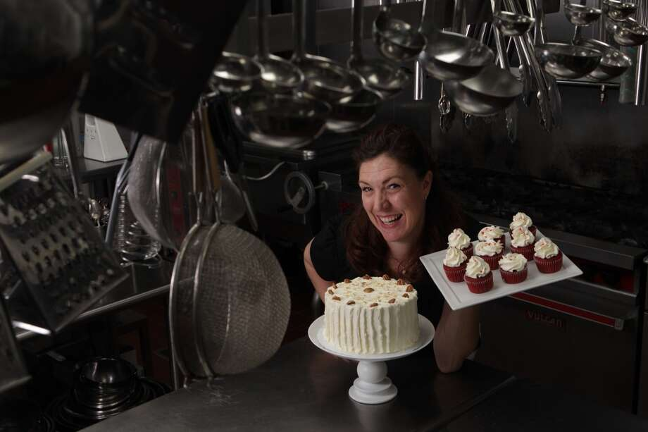 Jody Stevens poses for a portrait in the kitchen at Hofheinz House Tuesday, June 12, 2012, in Houston. Stevens, well-known locally as Jodycakes, specializes in vegan and gluten-free cakes. She has been selected by Agave in the Raw to create cakes using agave nectar instead of sugar. Her recipes will be available nationwide as part of a media campaign for the new Agave in the Raw. ( Brett Coomer / Houston Chronicle ) Photo: Brett Coomer, Houston Chronicle
