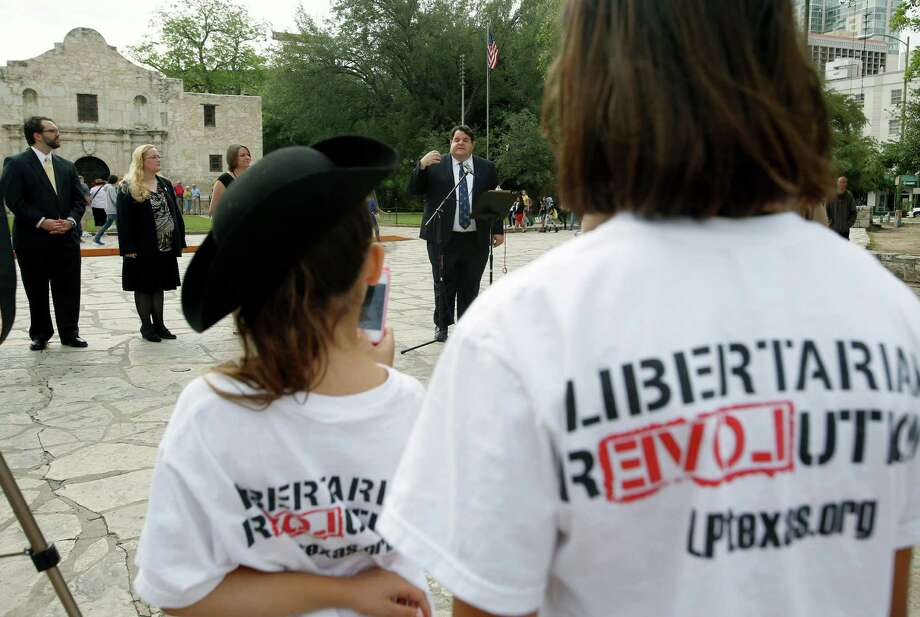 Libertarian party candidate for Texas lieutenant governor Robert Butler, at microphone, speaks Thursday May 1, 2014 in front of the Alamo about his election platform during a news conference for Libertarian party candidates seeking statewide office. Photo: William Luther, San Antonio Express-News / © 2014 San Antonio Express-News