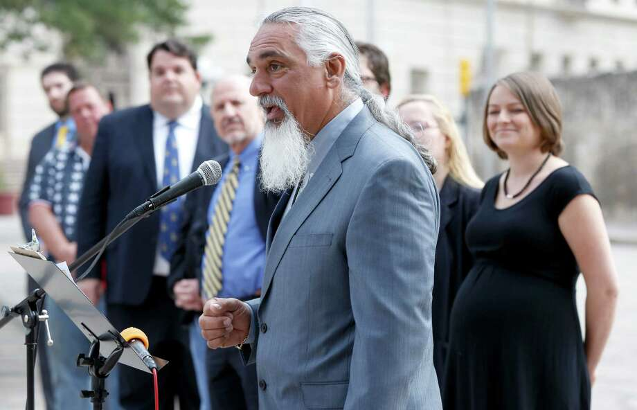 Libertarian party candidate for Texas attorney general Jamie Balagia, at microphone, speaks Thursday May 1, 2014 in front of the Alamo about his election platform during a news conference for Libertarian party candidates seeking statewide office. Photo: William Luther, San Antonio Express-News / © 2014 San Antonio Express-News