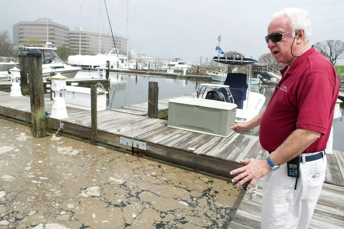 Dockmaster Carl Bochterie stands on the dock at Harbor House Marina where partially treated and non-disinfected sewage is floating in the water in Stamford Harbor in Stamford, Conn., on Thursday, May 1, 2014.