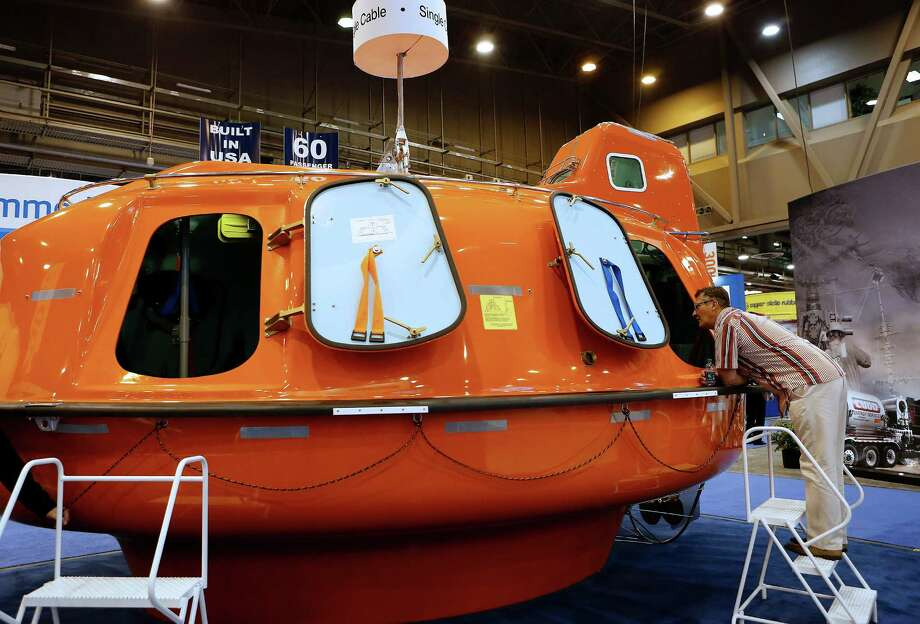 An attendee views a Survival Systems International Inc. lifeboat displayed at the company's booth during the 2013 Offshore Technology Conference (OTC) in Houston, Texas, U.S., on Tuesday, May 7, 2013. The Offshore Technology Conference (OTC) is organized and operated to promote and further the advance of scientific and technical knowledge of offshore resources and environmental matters. Photographer: Aaron M. Sprecher/Bloomberg Photo: Aaron M. Sprecher / © 2013 Bloomberg Finance LP