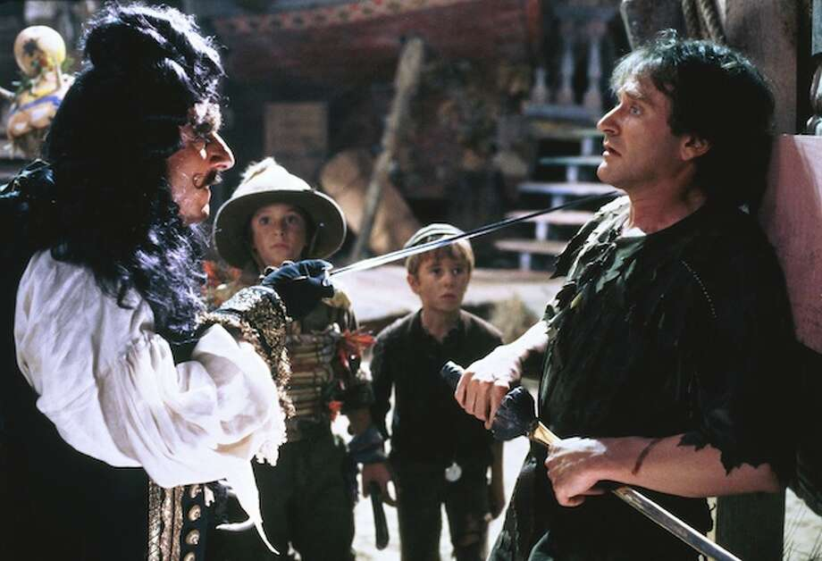 """""""Hook""""– Peter Pan grows up to become a soulless corporate lawyer whose workaholism could cost him his wife and kids. But when his kids are kidnapped by a vengeful Capt. Hook, Peter is forced to return to Neverland, where he gets a chance at redemption.Available Now! Photo: Netflix"""
