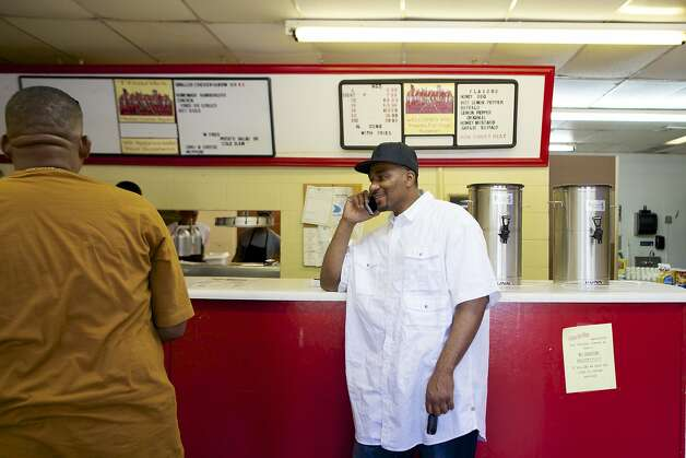 Aaron visits his workplace, Atlanta Hot Wings & More in Mobile, Ala., where he puts in six 10-hour shifts a week. Photo: Jeff Haller, Special To The Chronicle