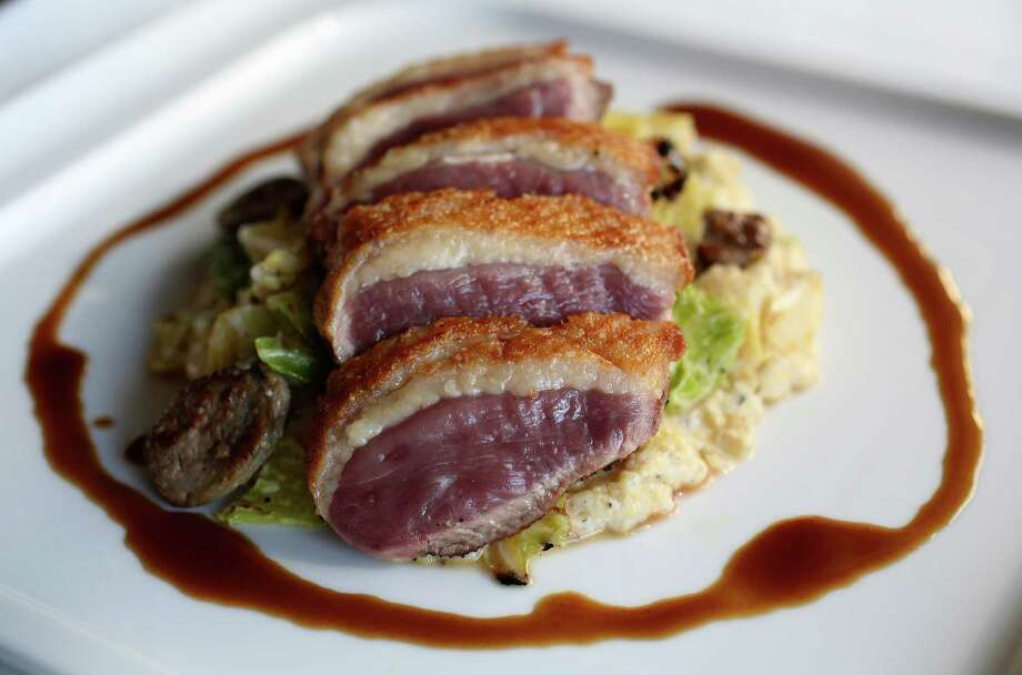 The Anatra (Rohan duck breast, buttered cabbage, duck sausage, and duck jus) at Osteria Mazzantini, Friday, Nov. 1, 2013, in Houston. ( Karen Warren / Houston Chronicle ) Photo: Karen Warren, Staff / © 2013 Houston Chronicle