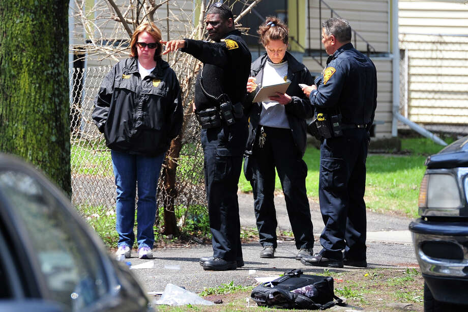 Police investigate at the scene where a 16 year-old male was shot in the neck on Park Ave., in Bridgeport, Conn. May 1, 2014. Police say the injuries are non-life threatening. Photo: Ned Gerard / Connecticut Post