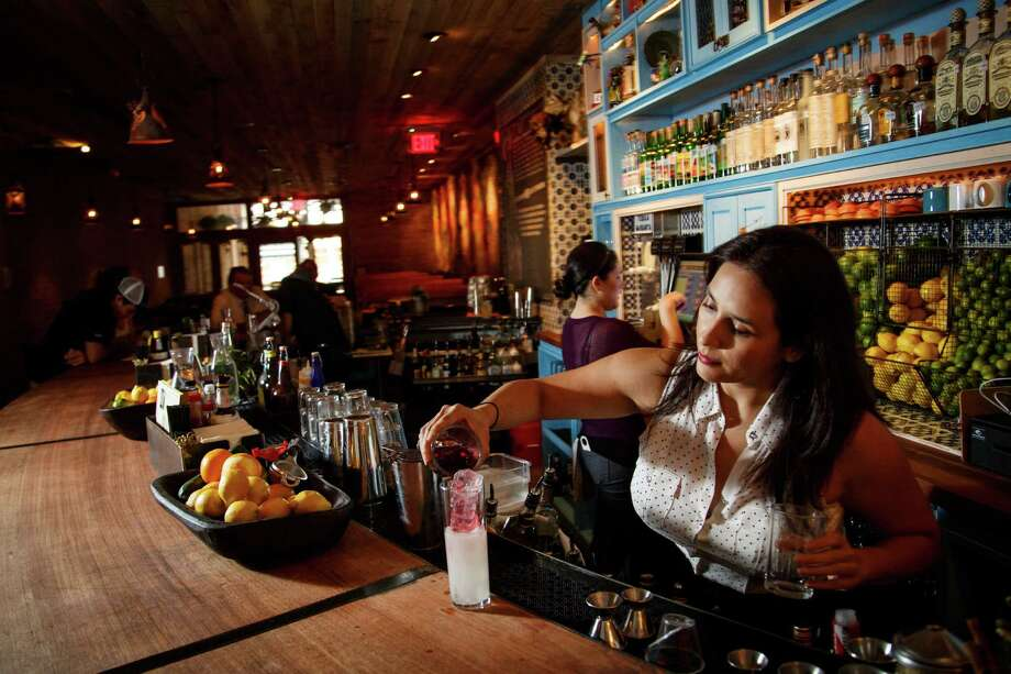 Alba Huerta makes a drink at The Pastry War, a new tequila bar downtown which serves agave-based spirits: tequila, mezcal and sotol, Wednesday, Aug. 21, 2013, in Houston. ( Michael Paulsen / Houston Chronicle ) Photo: Michael Paulsen, Staff / © 2013 Houston Chronicle
