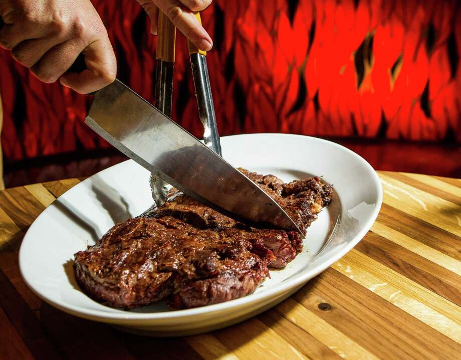 Make sure to bring a hearty appetite when dining at Mexican-style steakhouse La Casa del Caballo, where a steak can easily fill its own plate. Photo: Nick De La Torre, Staff / © 2013 Houston Chronicle