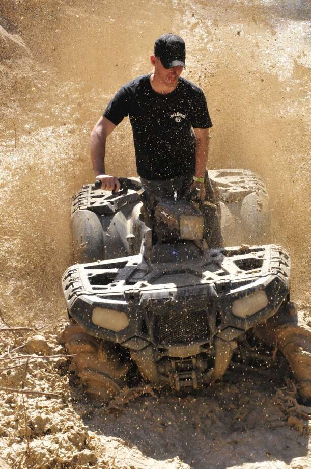 The Hardin County MusicFest in Kountze featured ATV muddin , helicopter rides and live entertainment. The event was hosted at the Big Thicket Trade Days on U.S. 69. Photo: Hardin County News