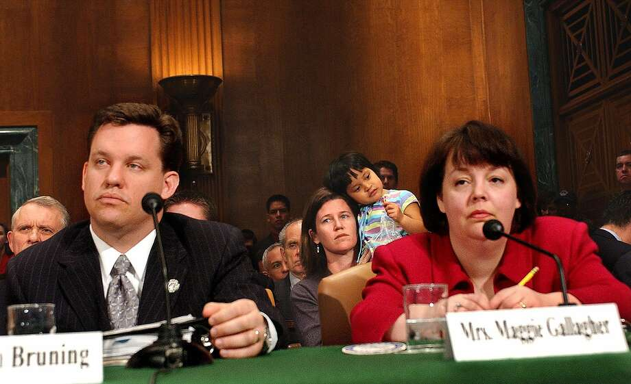 Nebraska Attorney General Jon Bruning and Maggie Gallagher, president of the National Organization for Marriage, testify before a Senate panel in March. Photo: Dennis Cook, ASSOCIATED PRESS