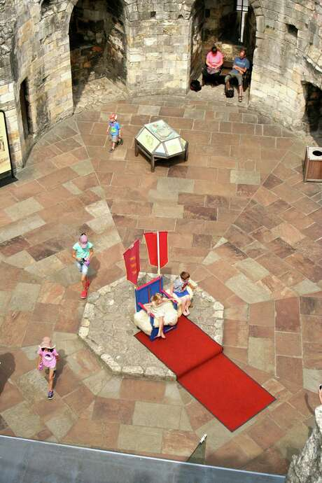 Kids can walk atop the wall and sit on a throne at Clifford's Tower, a 13th-century fortification that was once part of York Castle. Photo: Bonnie Wach / ONLINE_YES