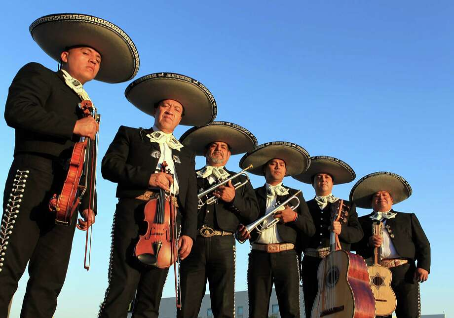 "Mariachi Emperadores de Mexico are Homero Barrios, from left, Luis Galvan, Manuel Ortega, Leonardo Arreola, Alejandro Valenzuela and leader Raul Medina. Mariachi music represents ""what it really means to be Mexican,"" Medina says. Photo: Mayra Beltran, Staff / © 2014 Houston Chronicle"