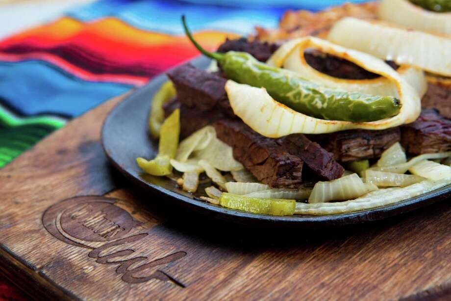 El Patio Mexican Restaurant's Fajita Combo with beef and chicken. Several restaurant employees have worked at El Patio for decades. Photo: Marie D. De Jesus, Staff / © 2014 Houston Chronicle