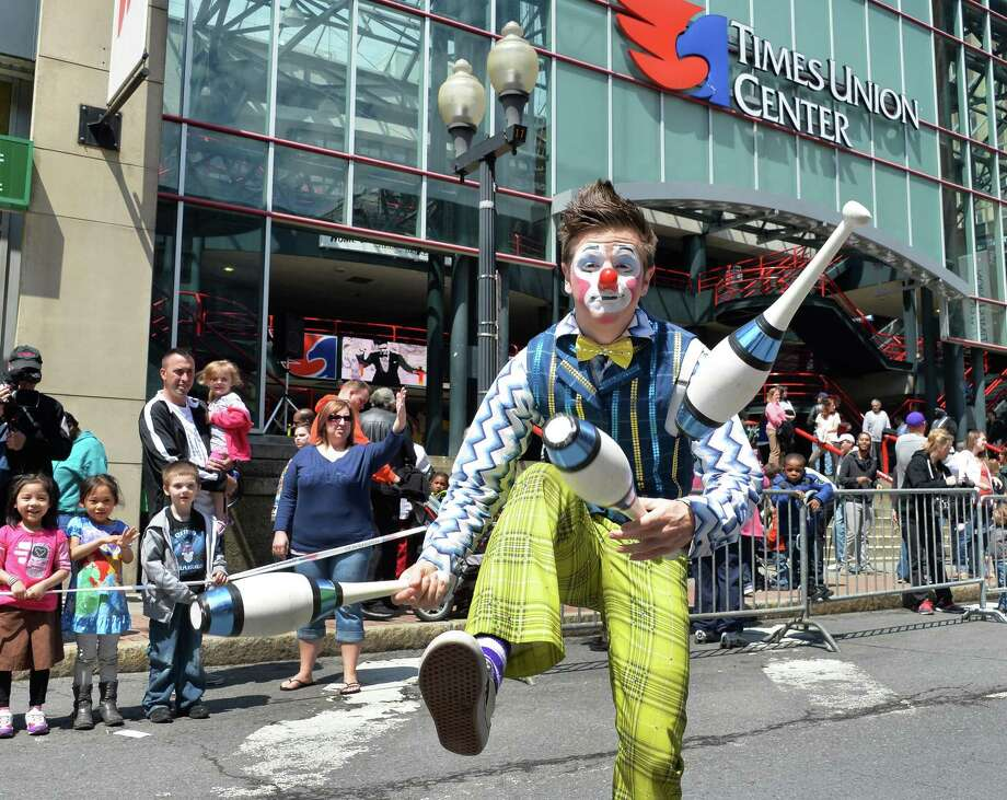 Ringling Bros. and Barnum & Bailey Circus clown Ben Macon juggles during an Elephant Brunch and Dance Party Thursday, May 1, 2014, outside the Times Union Center in Albany, N.Y.  (John Carl D'Annibale / Times Union) Photo: John Carl D'Annibale / 00026681A
