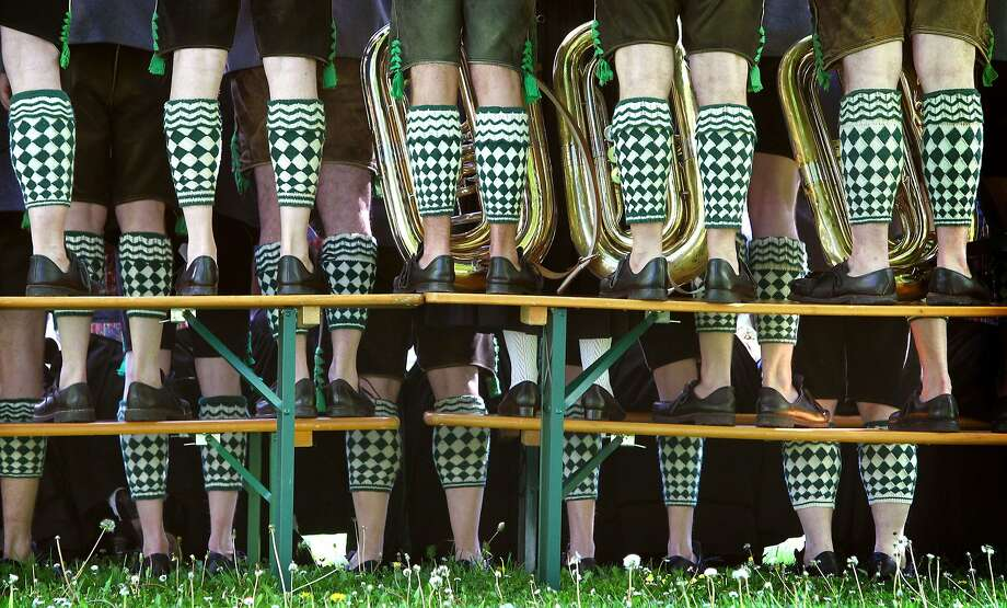 Leg warmers are never out of style:Traditional Bavarians wouldn't think of going out in public without covering up their pasty calves. (Oompah band members in Garmisch-Partenkirchen, Germany.) Photo: Karl-josef Hildenbrand, AFP/Getty Images