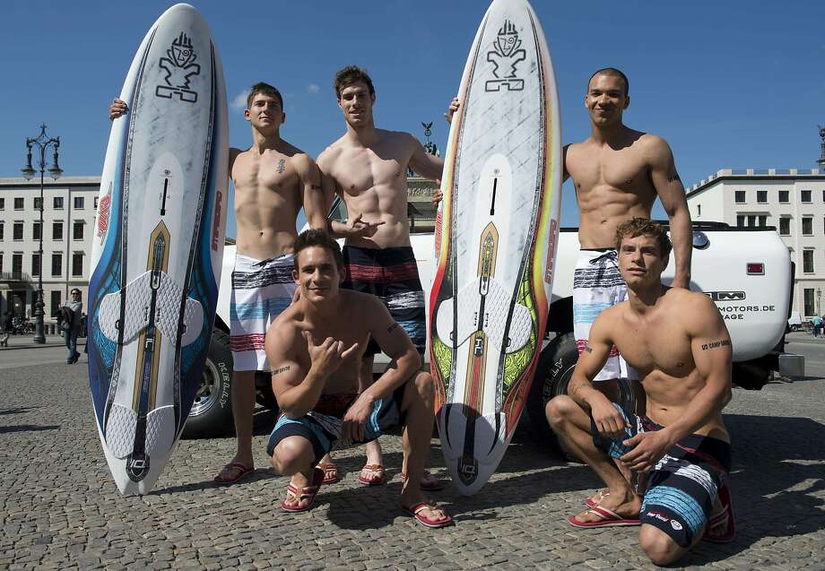 Surf's up at ... the Brandenburg Gate? We're beginning to suspect these guys aren't real surfers. (Photo shoot for apparel maker Camp David's Spring/Summer 2014 collection in Berlin.) Photo: John MacDougall, AFP/Getty Images