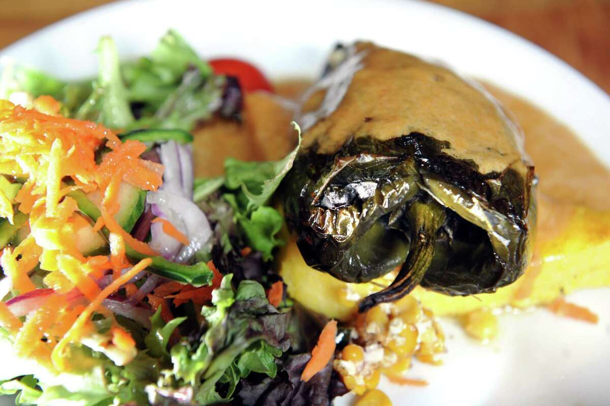 Stuffed Poblano Peppers, goat cheese, roasted corn and scallion stuffed poblano peppers over polenta cakeand served with salad on Wednesday, April 23, 2014, at The Capital American Eatery and Lounge in Albany, N.Y. (Cindy Schultz / Times Union)