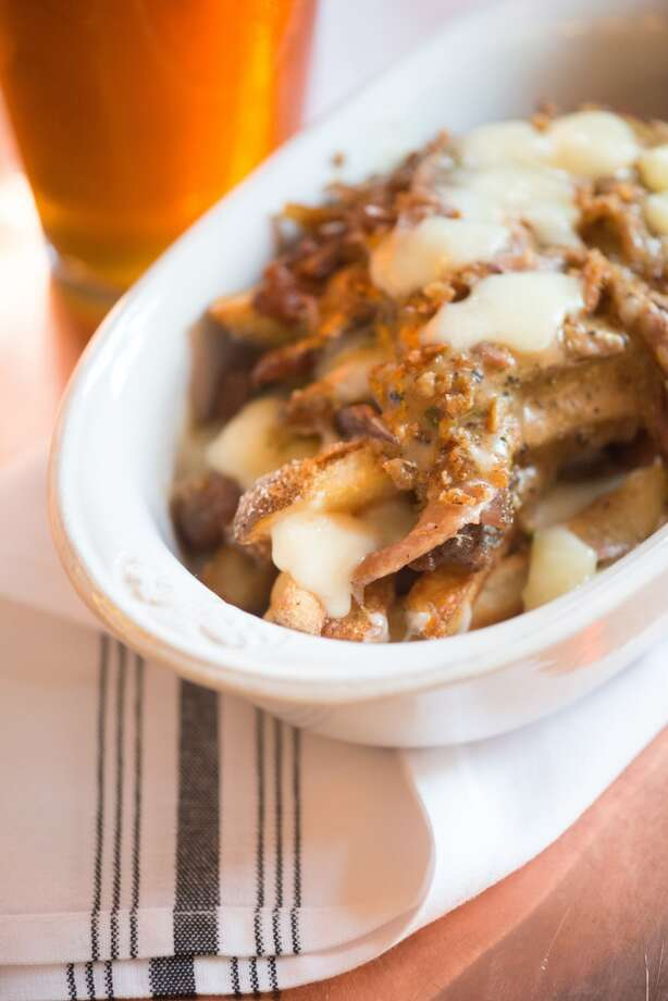 Poutine: duck confit, curd cheese, kennebec fries, peppercorn gravy $11 Photo: Kristen Loken