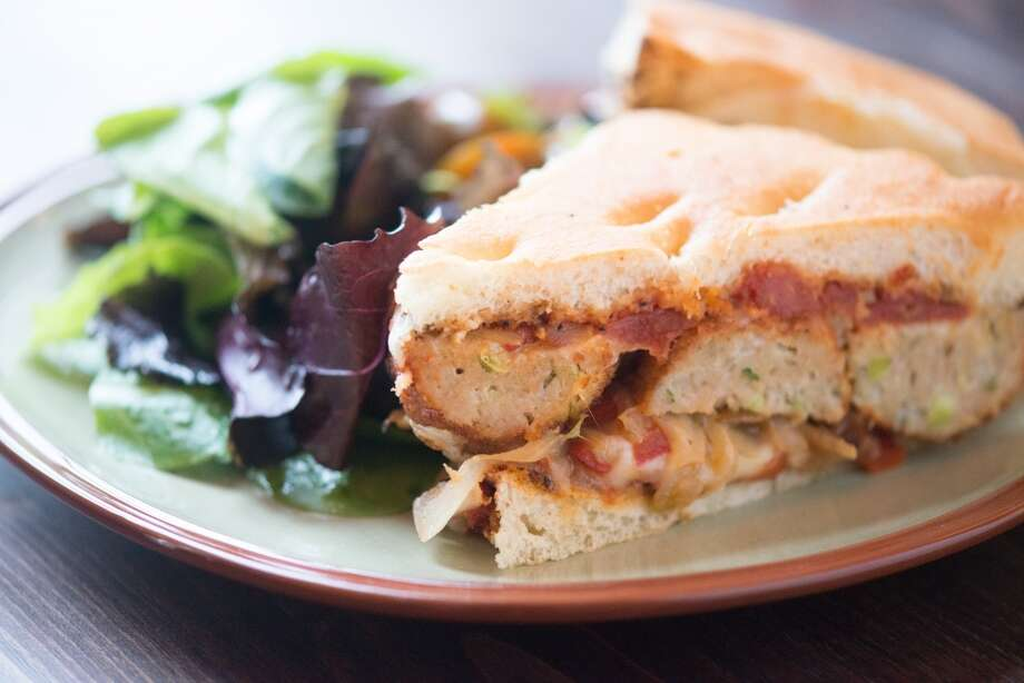 Chicken Meatball Focaccia Sandwich: pepper and onion compote,  provolone and mozzarella cheeses, oven dried roma tomatoes with spice, green salad $13 Photo: Kristen Loken