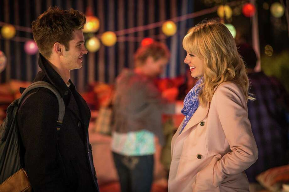 "This image released by Sony Pictures shows Andrew Garfield and Emma Stone in ""The Amazing Spider-Man 2."" (AP Photo/Columbia Pictures - Sony Pictures, Niko Tavernise) ORG XMIT: NYET115 Photo: Niko Tavernise / Columbia Pictures - Sony Pictures"