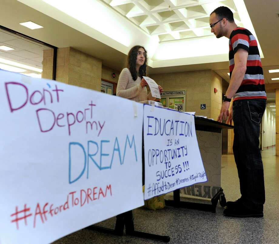 Danbury resident and Western Connecticut State University graduate, Carolina Bortolleto, left, co-founder of  Connecticut Students for a DREAM, talks with Ramon Velazquez, 27, a junior at Western Thursday, May 1, 2014. Connecticut Students for a DREAM want Connecticut to allow undocumented students to be eligible to receive schoarships that are funded with their tuition money. Photo: Carol Kaliff / The News-Times