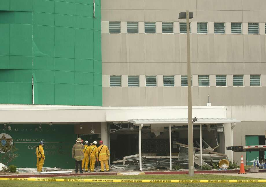 Rescue personnel enter the Escambia County Jail in Pensacola, Fla., after an apparent gas explosion. About 600 inmates were in the building at the time of the blast. Photo: Michael Spooneybarger, Reuters