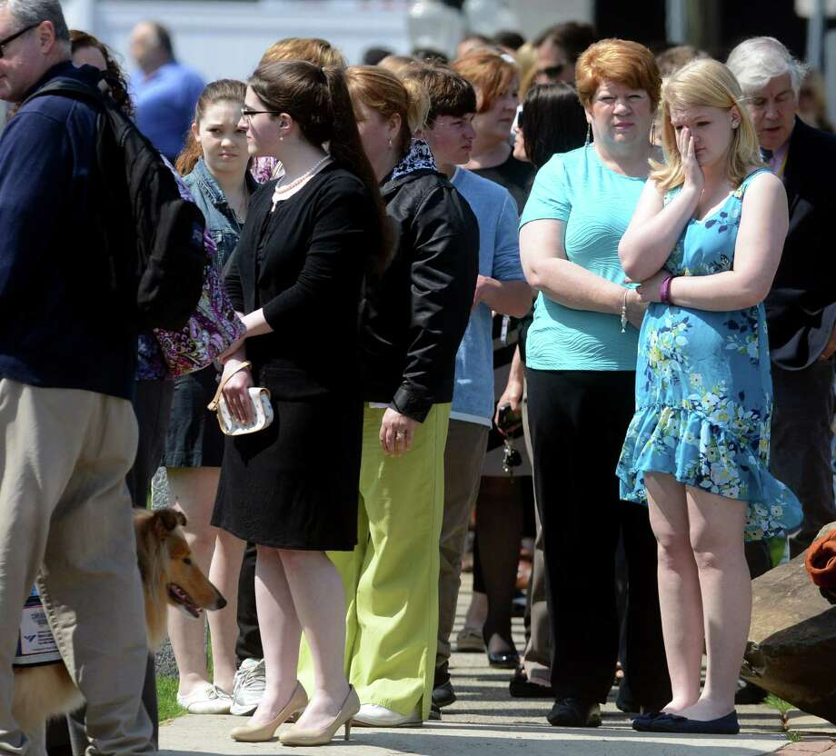 A large crowd of mourners lined up outside The Cody White Funeral Home in Milford, Conn. on Thursday, May 1, 2014. Hundreds came to pay their respect to the family of Maren Sanchez, the 16 year-old Jonathan Law High student who was fatally stabbed at school last week. Photo: Autumn Driscoll / Connecticut Post