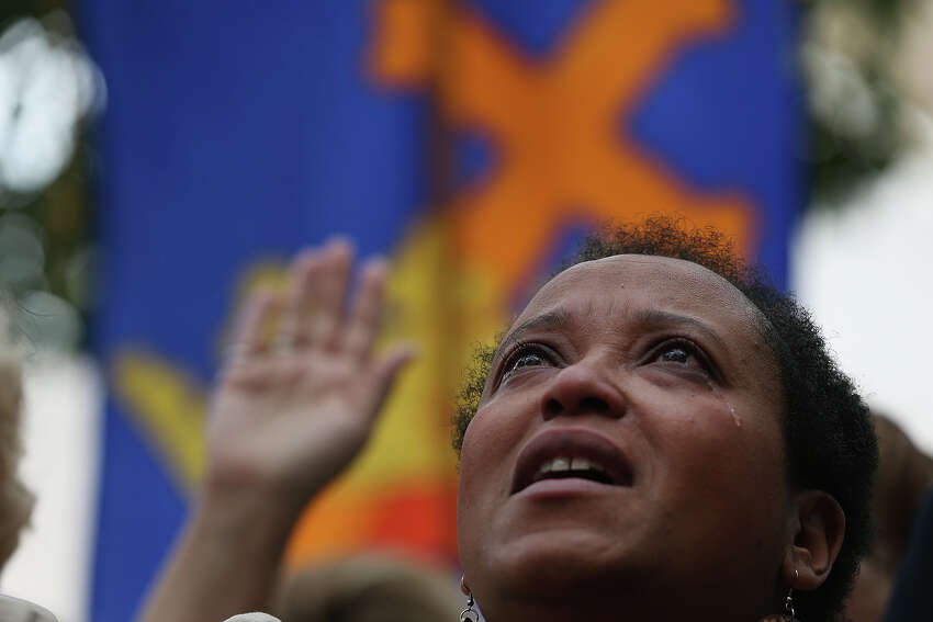 Natalie Hardy participates in the National Day of Prayer in front of City Hall, Thursday, May 1, 2014. The event, titled