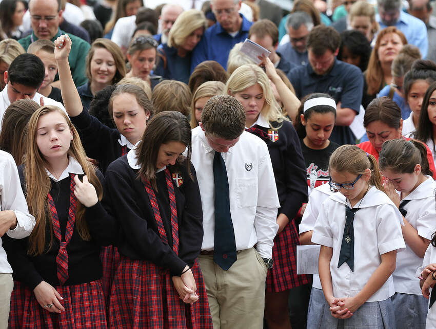 Students pray during National Day of Prayer in front of City Hall, Thursday, May 1, 2014. The event, titled
