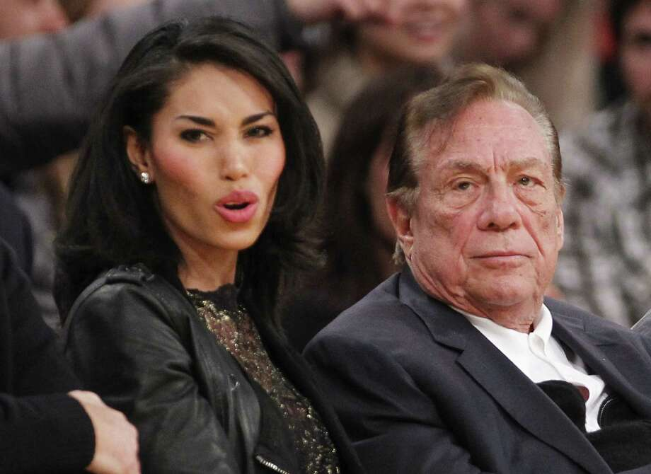 Los Angeles Clippers owner Donald Sterling and friend V. Stiviano watch the Clippers play. (Sterling has been banned from NBA events and management.)   Photo: Associated Press Photos / FR161655 AP