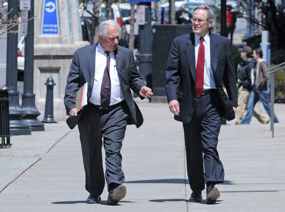Lawyers, William Dreyer, left, and E. Stewart Jones, make their way into the Federal Courthouse on Thursday, May 1, 2014, in Albany, N.Y.  The two men are representing former state Senate Majority Leader Joseph Bruno in his corruption trail which begins next week.  (Paul Buckowski / Times Union) Photo: Paul Buckowski / 00026713A