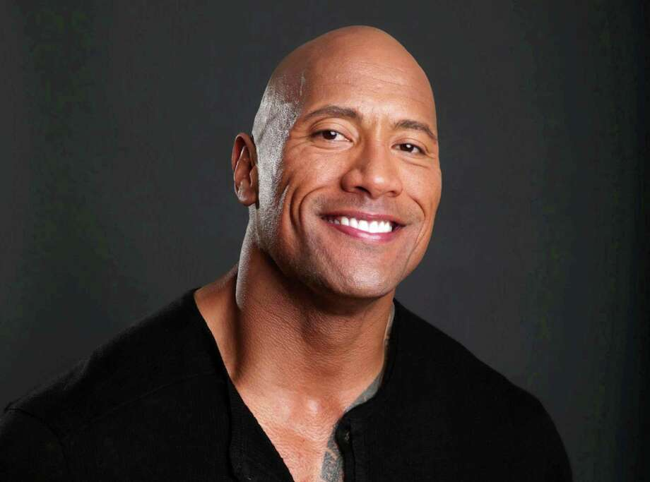 """FILE - This March 23, 2013 file photo shows actor Dwayne Johnson posing for a portrait at the Four Seasons in Los Angeles. Johnson also hosts """"The Hero,"""" competition series on TNT.  The season finale airs Thursday, Aug. 1. (Photo by Eric Charbonneau/Invision/AP, File) ORG XMIT: NYET760 Photo: Eric Charbonneau / Invision"""