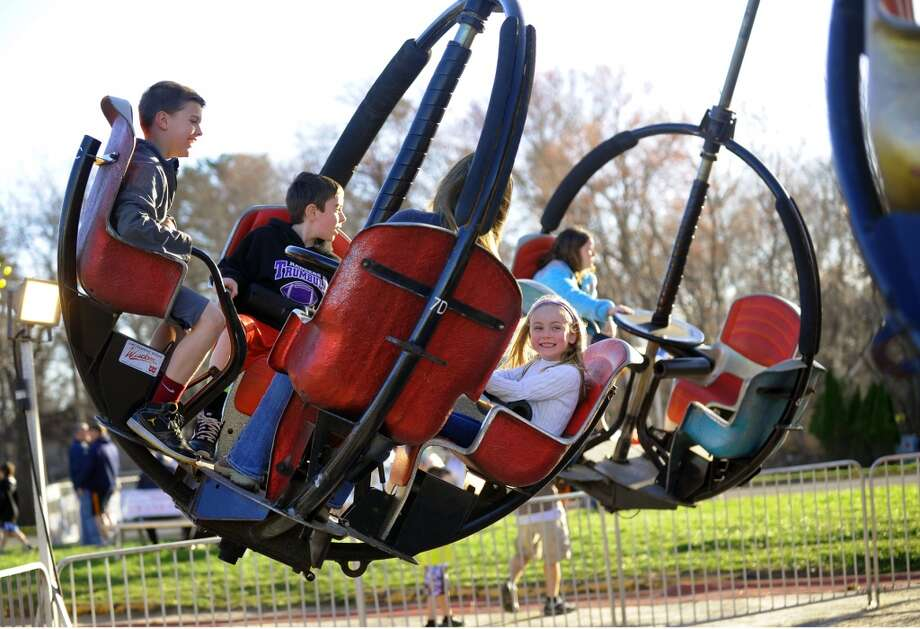 No. 6: Trumbull has the sixth highest percent of women between the ages of 35 and 50 having children of all towns in Southwestern Connecticut where at least 100 mothers gave birth in a recent year, according to census data. The national average is 20 percent.    Maddie Moffat, 6, enjoys a ride on the Tornado with her brother Jake, 9, at left, friend Jack Arcamone, 8, and mom Jenn, during the Trumbul Rotary Club Carnival at Hillcrest Middle School in Trumbull, Conn. on Wednesday April 17, 2013. The carnival continues through Sunday April 21st. This year, money raised will go towards building a home in Bridgeport for a vet's family through the work by the Trumbull Rotary Club and Habitat for Heroes. More information can be found at www.trumbullrotary.org and www.habitatcfc.org. Photo: Christian Abraham