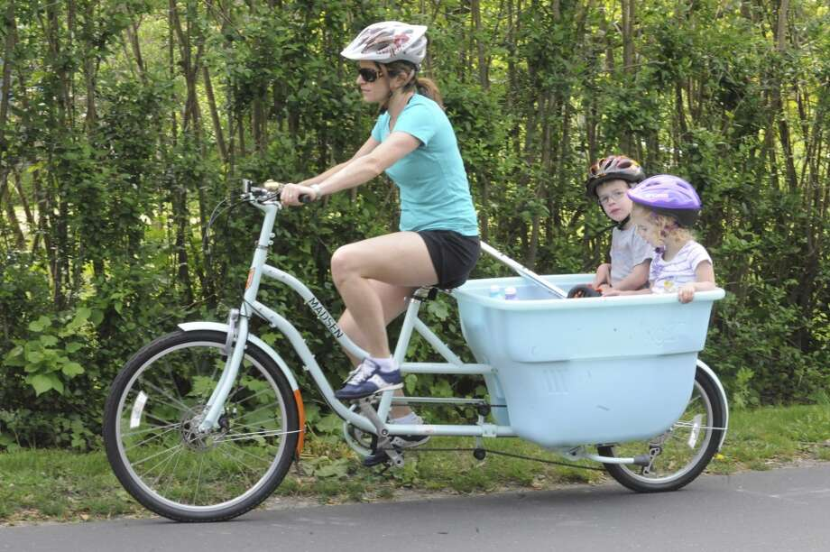 No. 5: Greenwich has the fifth highest percent of women between the ages of 35 and 50 having children of all towns in Southwestern Connecticut where at least 100 mothers gave birth in a recent year, according to census data. The national average is 20 percent.    Lauren Jones bicycles with her children Mason, 4 and Madeline, 2, at Greenwich Safe Cycling's celebration for Mother's Day and National Bike Month Sunday, May 13, 2012. The event starts at Eastern Greenwich Civic Center, Old Greenwich, and goes around Greenwich Point. Photo: Helen Neafsey