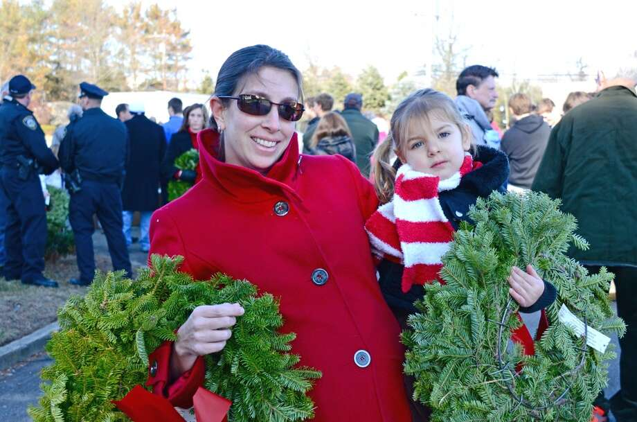 No. 2: Darien has the second highest percent of women between the ages of 35 and 50 having children of all towns in Southwestern Connecticut where at least 100 mothers gave birth in a recent year, according to census data. The national average is 20 percent.    Mother and daughter, Tabitha and Tatum Wunderlich carry wreaths to place on soldiers' headstones during the Wreaths Across America ceremony at Veterans Cemetery last Saturday, Dec. 15, 2012, in Darien, Conn. Photo: Jeanna Petersen Shepard